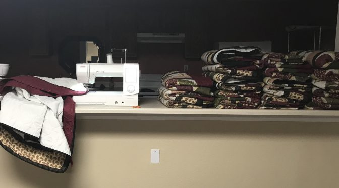 Stretching a quilt and lighting the way
